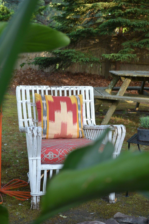 rattan chair Sunbrella cushions.jpg