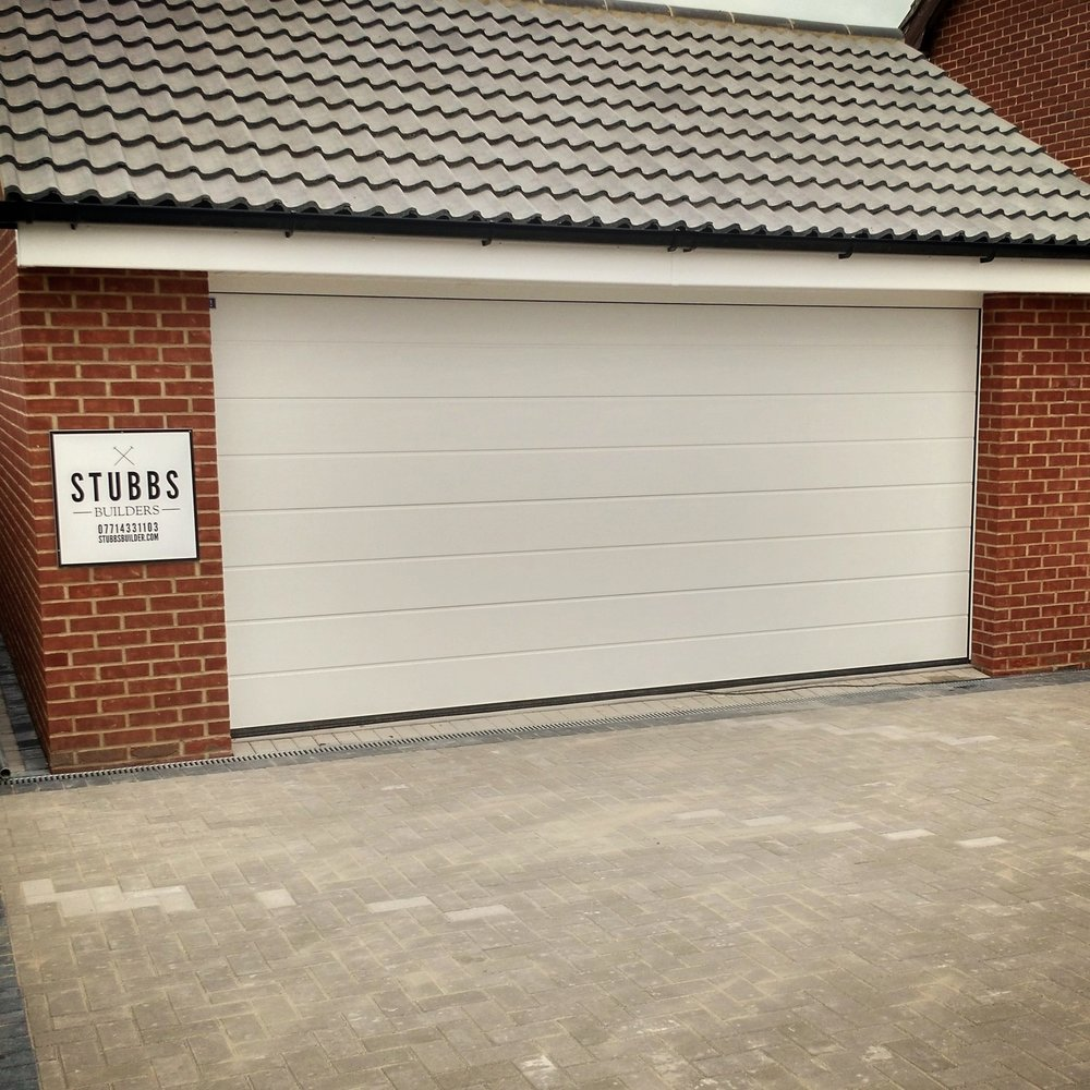 Garages  - Garages can generally be built in your garden or on the land around your house, without the need for planning permission.However Building Regulations approval is needed for the construction of a garage attached to an existing home, as well as converting a garage into habitable use. Read more here.