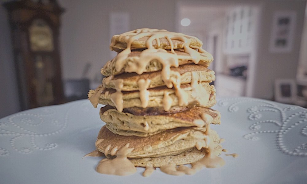 Paleo plantain pancakes drizzled with almond butter.