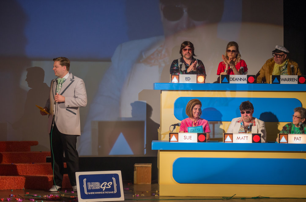 Clark Ramsey, host, waits to see of the contestants can match any of the Celebrity Panel from the 2016 Harbor Beach Gameshow Series.