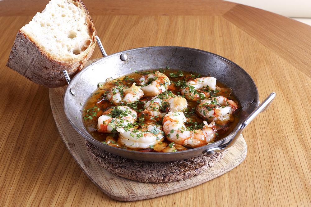 Gambas al Ajillo: Shrimp, garlic, brandy, and Guindilla pepper in olive oil. Source: Boqueria.