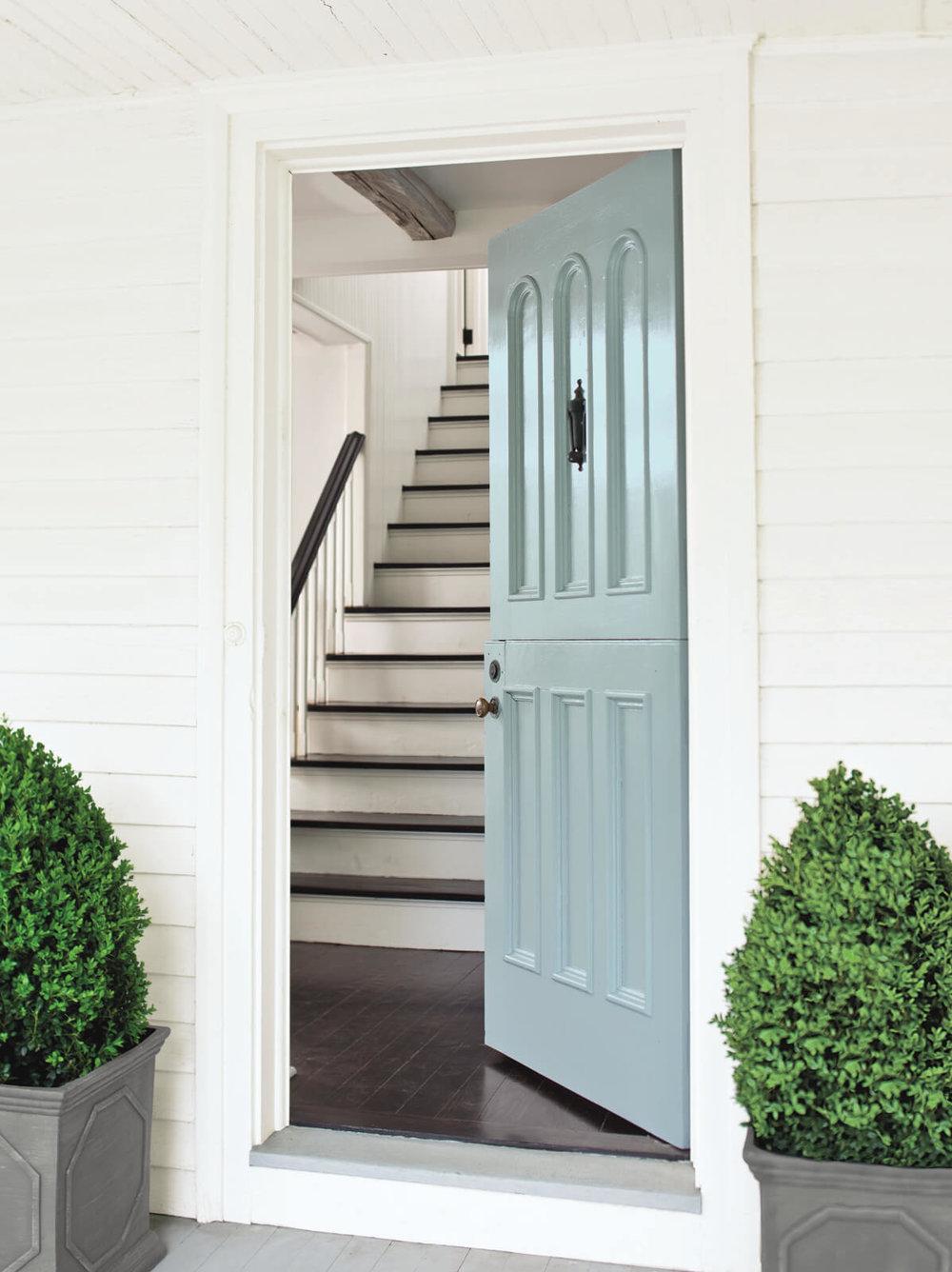 White_Exterior_with_Blue_Front_Door.jpg