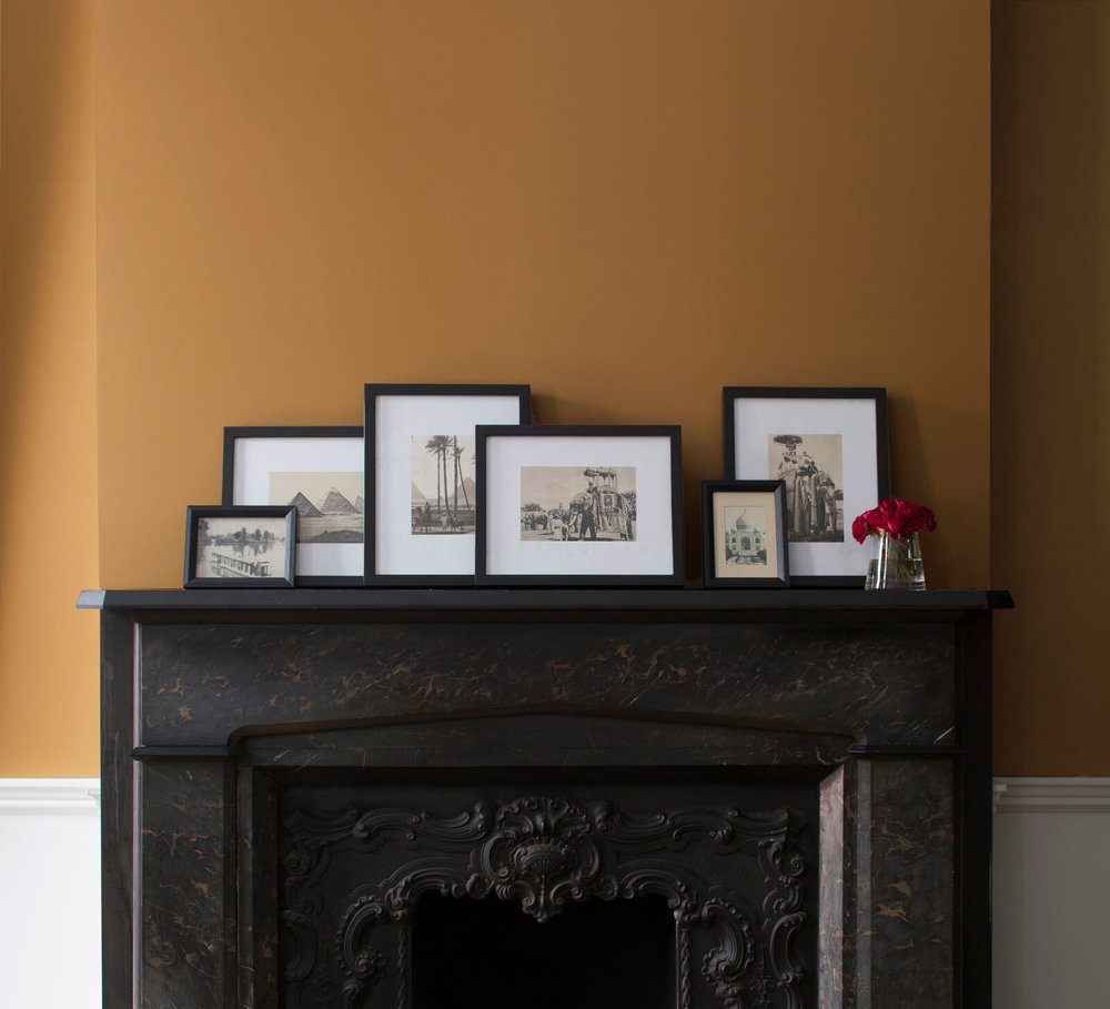 Black_Fireplace_with_Gold_Wall.jpg