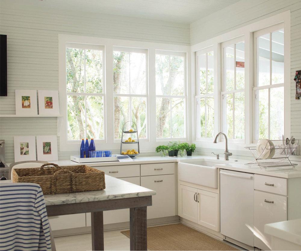 Pale_Green_Kitchen_with_Corner_Windows.jpg