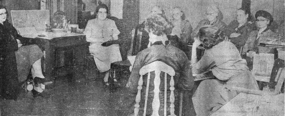 GENERAL MEETING of the Bainbridge Arts and Craft was held recently at the Gift Shop in the Review Building. Mrs. Tom Bourns, Wing Point, chairman, and Mrs. John Rudolph, Sunrise Drive, secretary, are sitting with their backs to the camera. Others in attendance were from the left; Mrs. Bert Murley, Winslow; Mrs. H. Clinton and Capt, Invald Wick, both of Eagledale; Mrs. Wick; Mrs. A. K.Meyers, Port Madison; Mrs. I. Haugen, Eagledale and Mrs. George Dennis, Sunrise Drive. It was at this meeting that first plans were laid for an all-Island fair this summer.