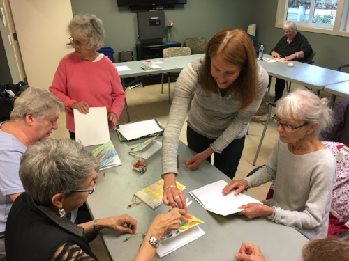 TAP artist Karen Cornell instructs collage techniques during one of our free monthly workshops at Bainbridge Island Senior Center.