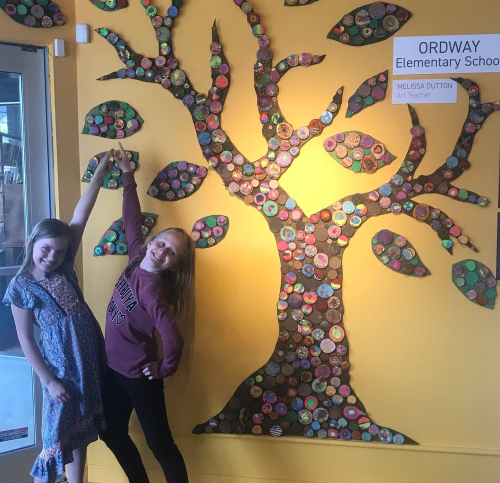 Proud Ordway students point out each of their pieces on the Ordway group artwork.