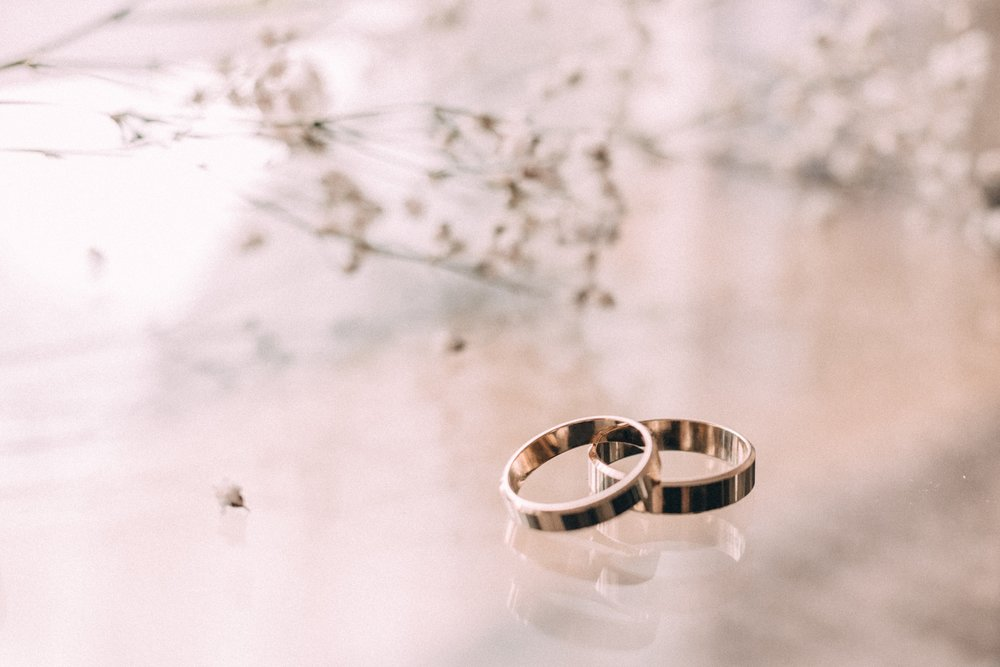 negative-space-wedding-rings-glass-table-love.jpg