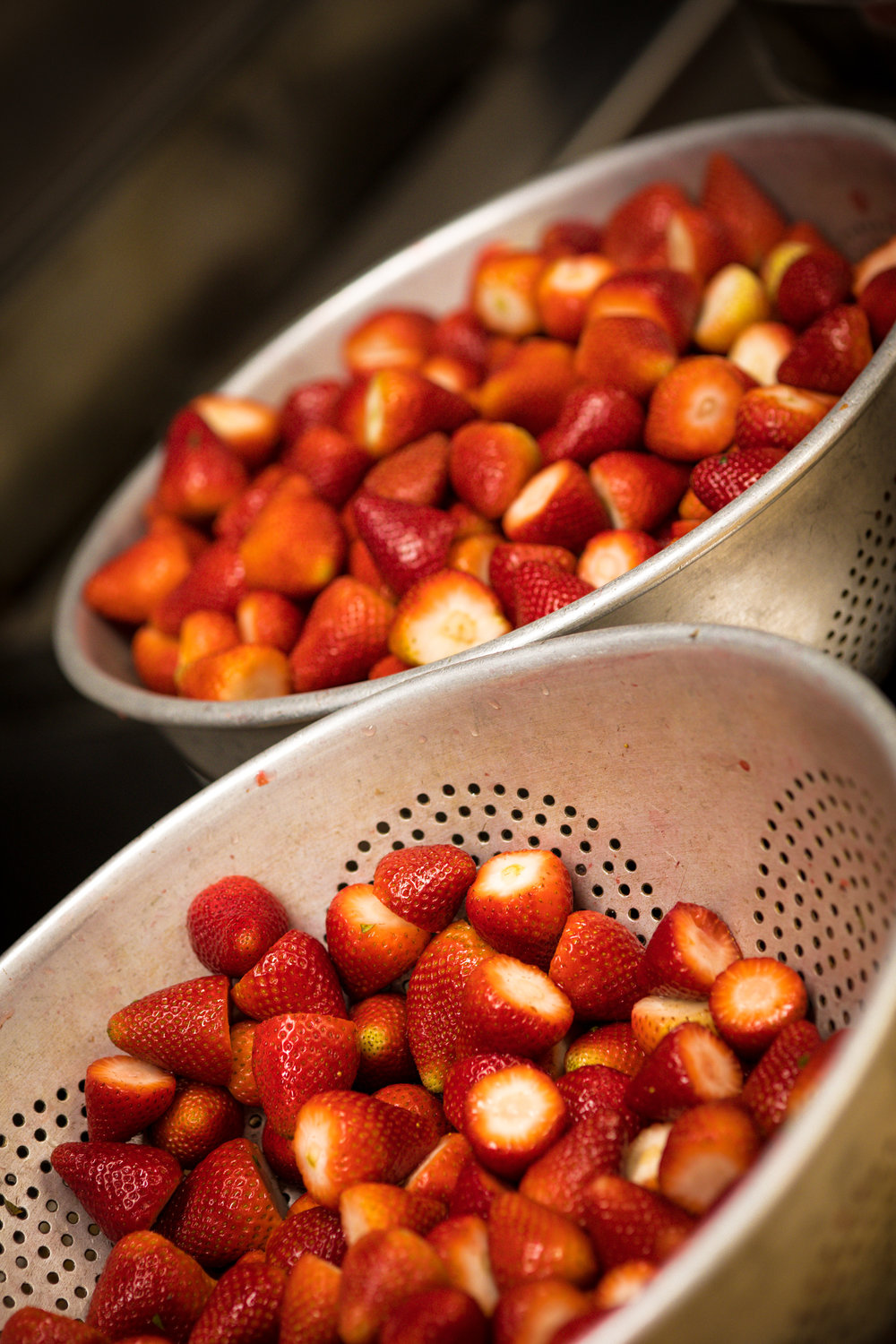 Crates of fresh strawberries are used daily in our cakes.