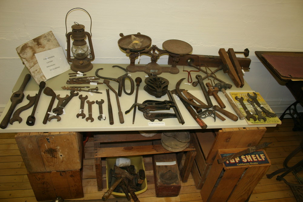 A farmer had to be a handy man too. These are many of his tools of the trade on display in the Agriculture Room.