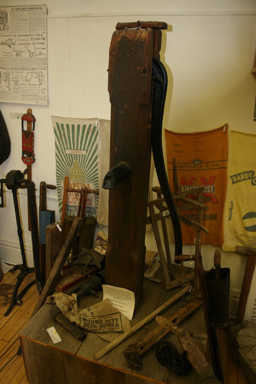 This wooden pump served an area farmer many years ago. Tools, implements and grain sacks were found in every barn.