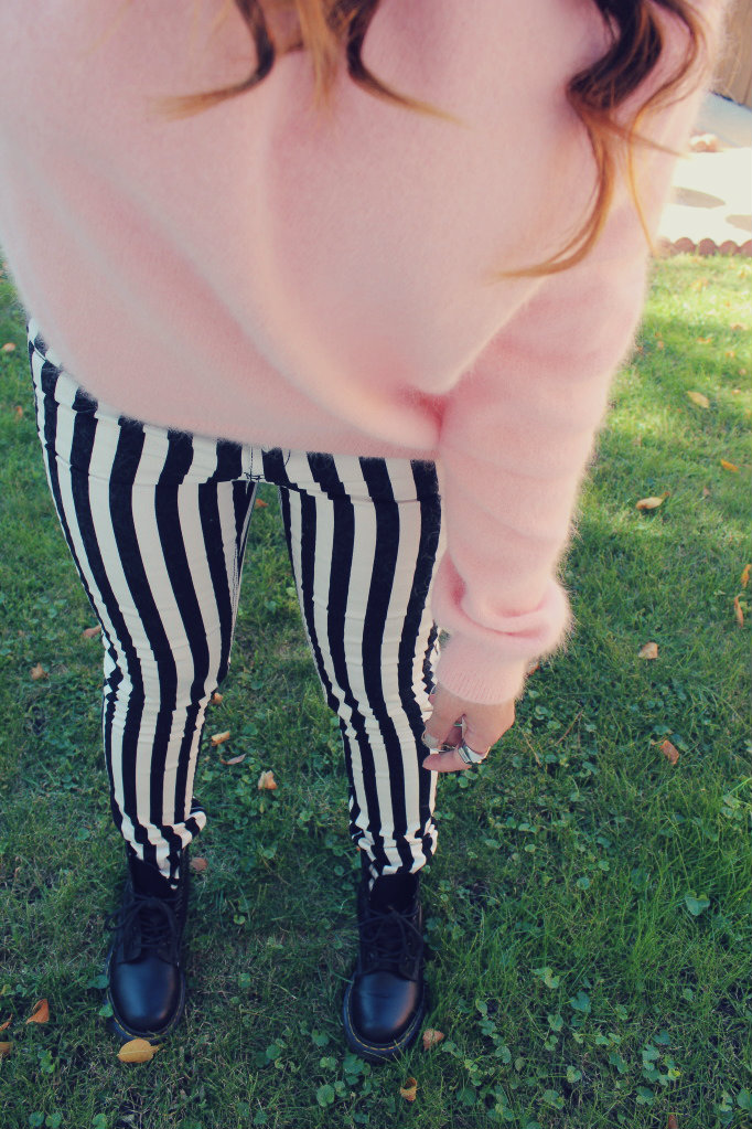 pink fuzzy sweater and black and white striped pants outfit of the day