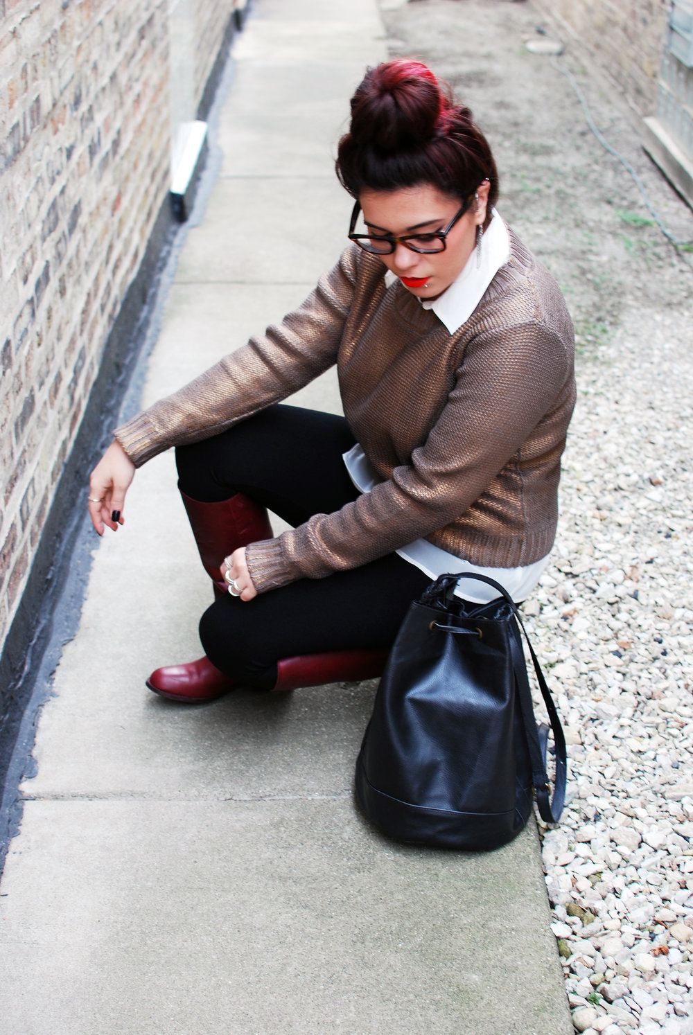 metallic sweater and oxblood boots