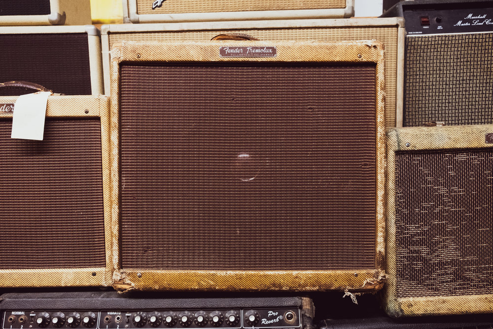 Tremolux! On tour I play through a '65 reissue Reverb Deluxe and at home I've got an go 60's black face Vibrolux that was used to call out bingo numbers at a church in Scranton for decades.