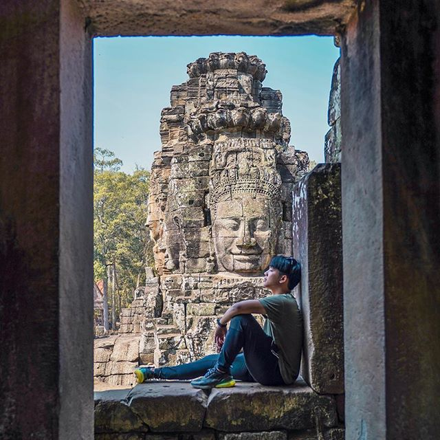 """World traveler, Army (insta: @armypalakorn) shares with us his views from Cambodia's Bayon Temple: """"Known as The Face Temple, Prasart Bayon is at the heart of Angkor Thom 🗿 Its 54 Gothic towers are famously decorated with 216 gargantuan smiling faces. Impressive!"""""""
