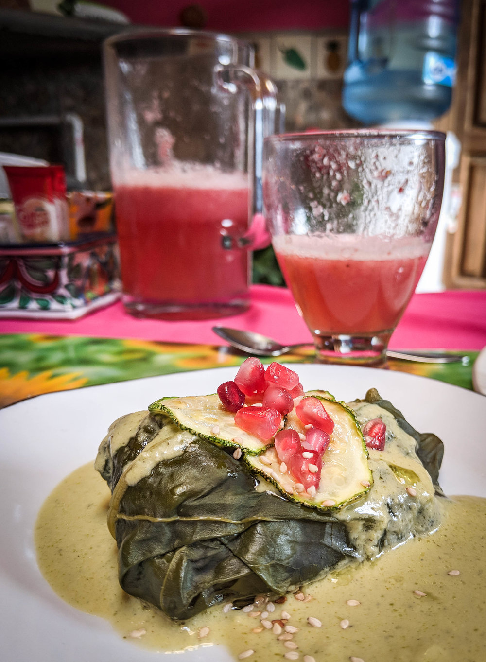 Spinach tamales with avocado cream sauce
