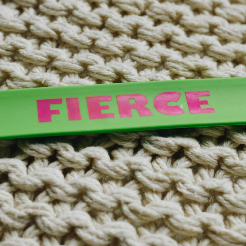 The slap bracelet Kate found on her wrist after waking up from surgery.