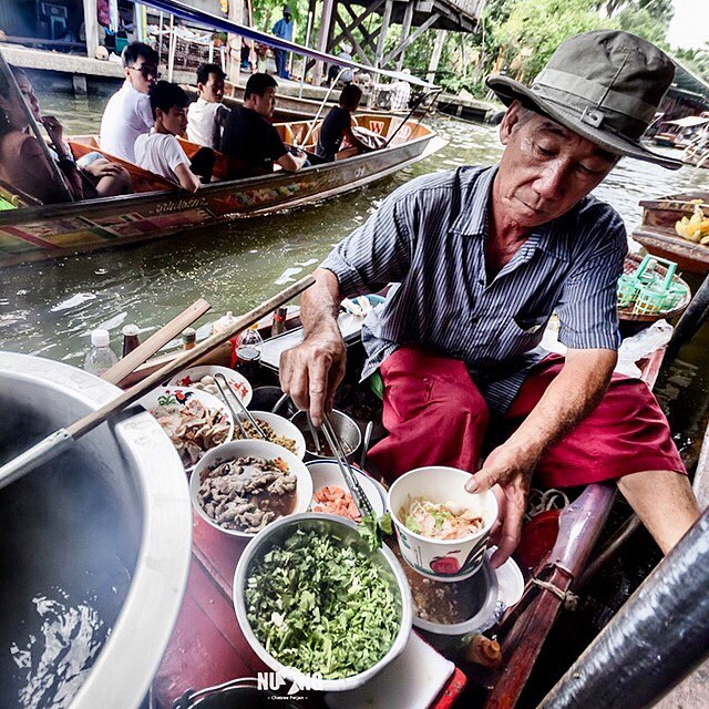 "The history of ""Boat Noodle Soup"" has started very long time ago. This noodle has been selling on a small boat, and feeding many people who lives along the river for more than 360 years and still today. The picture was taken at Amphawa Floating Market, 🇹🇭"
