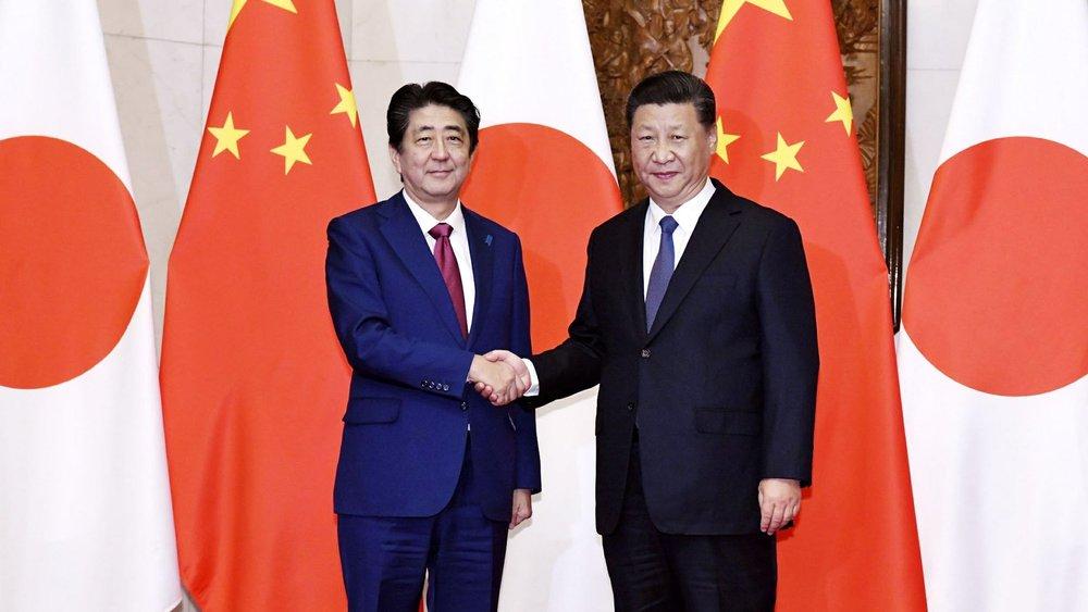 Kyodo News / AP