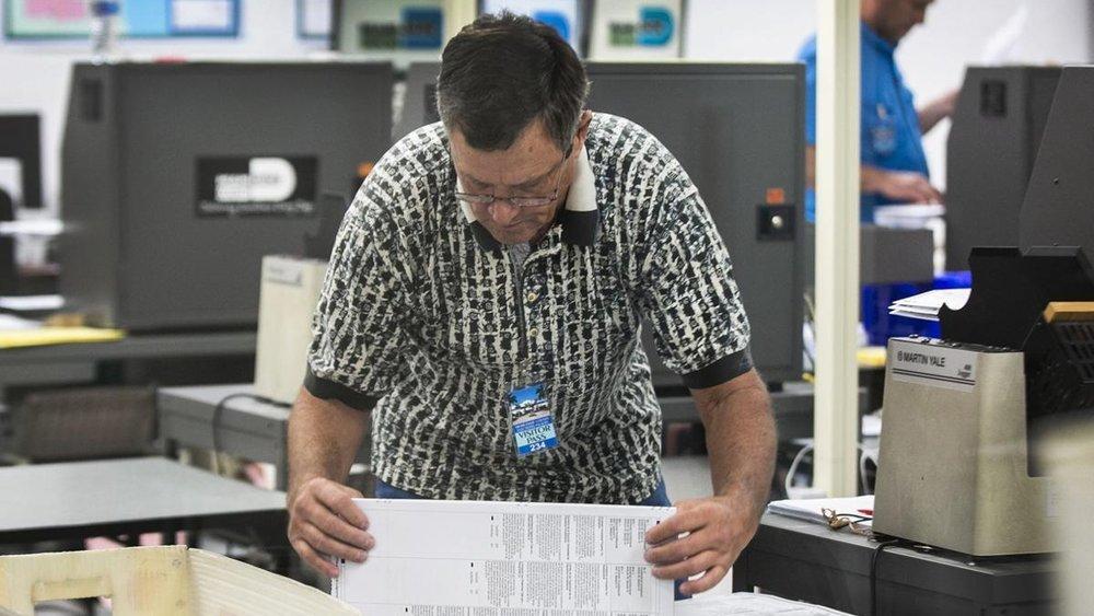C.M. Guerrero / Miami Herald / AP