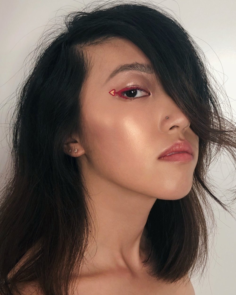 This look was created with  Sigma Line Ace  in Sigma Pink and  Jane Cosmetics Water Resistant Eye Liner  in 14k Gold! For her highlights, I used  Maybelline Face Studio Master Chrome Metallic Highlighter  100 Molten Gold