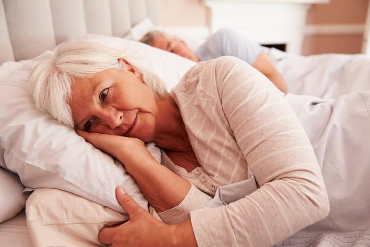 elderly couple in bed, woman wide awake.jpg