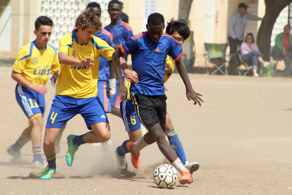 Dakar Students use soccer to create relationships with locals in Senegal.