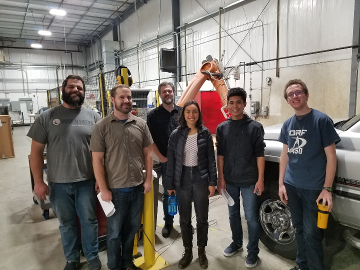 Team Members with H2O Jet's Robotic Arm