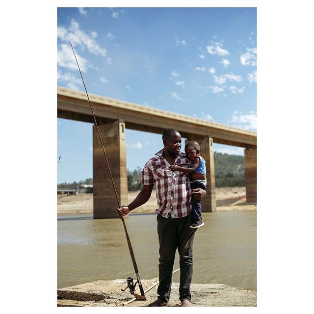 "Portrait of Jason and his son Jason jr. from the story ""day zero"" at capetown infront of the Theewaterkloof dam. Capetown is one of the bigger cities facing water crisis."