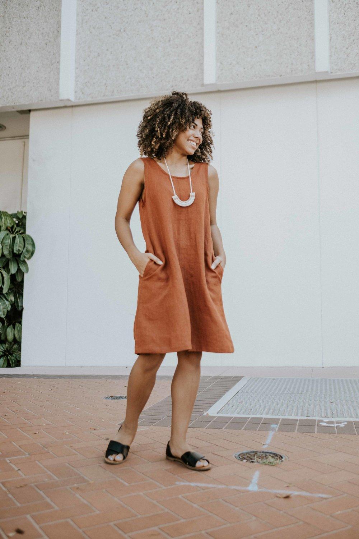 Solie modeling the Elinor Dress Scoop Back Dress featured in rust linen