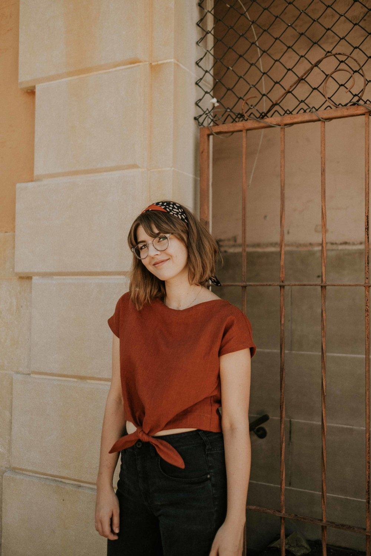 Anna (hi, hello) modeling the Madeline Tie Crop Top featured in rust linen