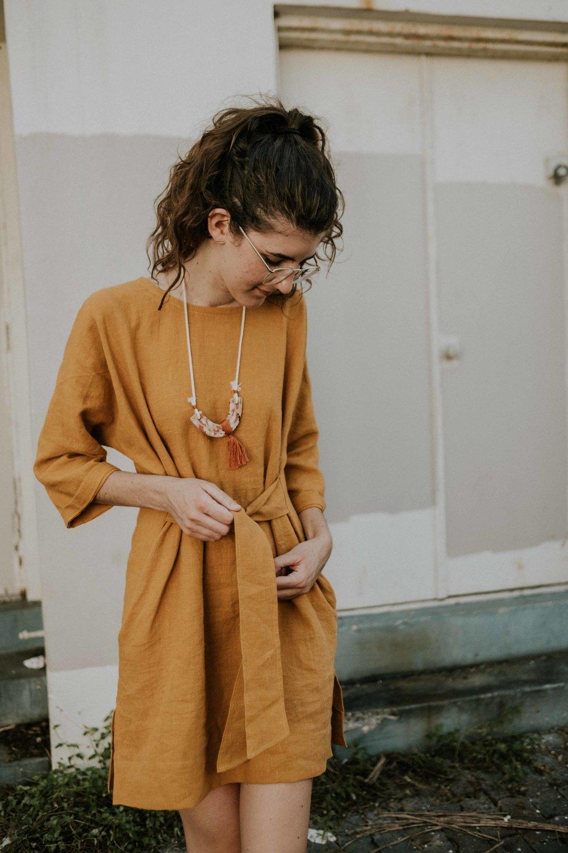Amanda modeling the Gabriella Tie Dress featured in golden linen (my personal favorite!)