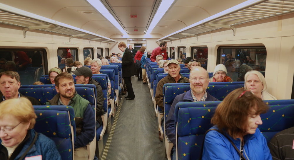 "Passengers ready for their joy ride in a refurbished 1950s-era diesel railcar, known as a ""Budd car""  Photo: Julie Campoli"