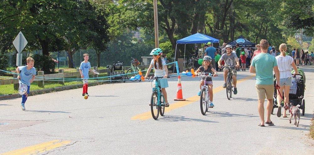 Families enjoying an annual Open Streets BTV event in Burlington's South End in 2017  Photo credit: Local Motion