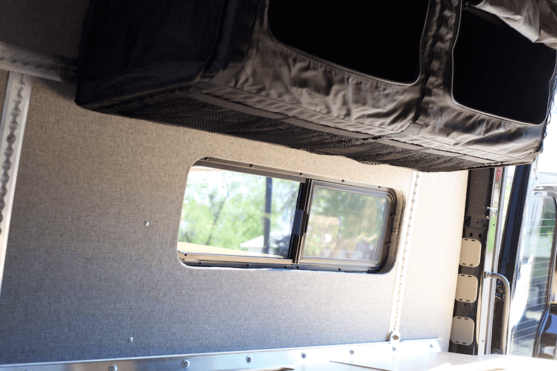"Custom 33"" window and trim below the kit's overhead mule bags"