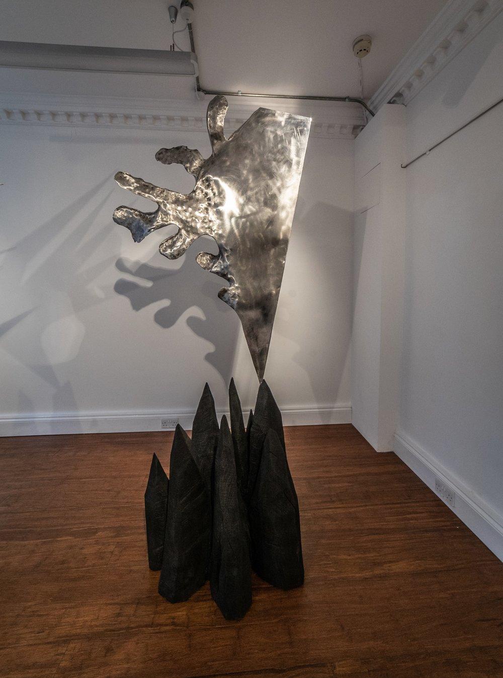 Sol Bailey-Barker  Caldera , 2018 Charred Oak & Stainless Steel 226 cm x 102 cm x 64 cm