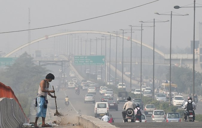 The skyline of Delhi remains hidden on a November morning.  Image source:  Prakash Singh/Agence France-Presse — Getty Images