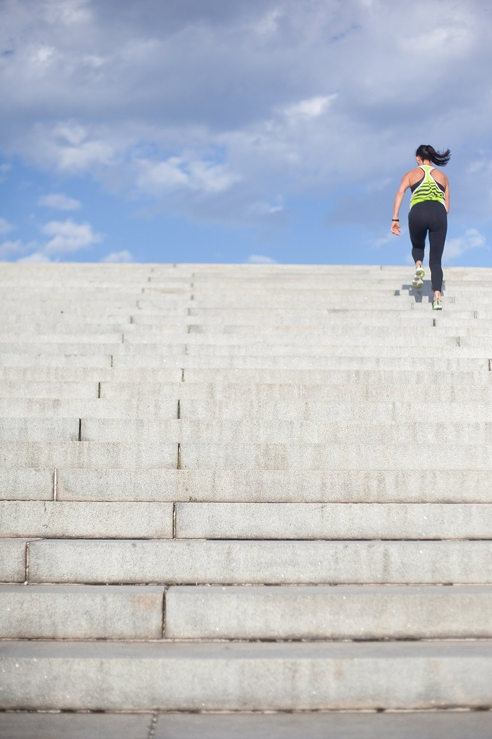You Your Brand personal brand image of woman running up steps at Washing DC Monument
