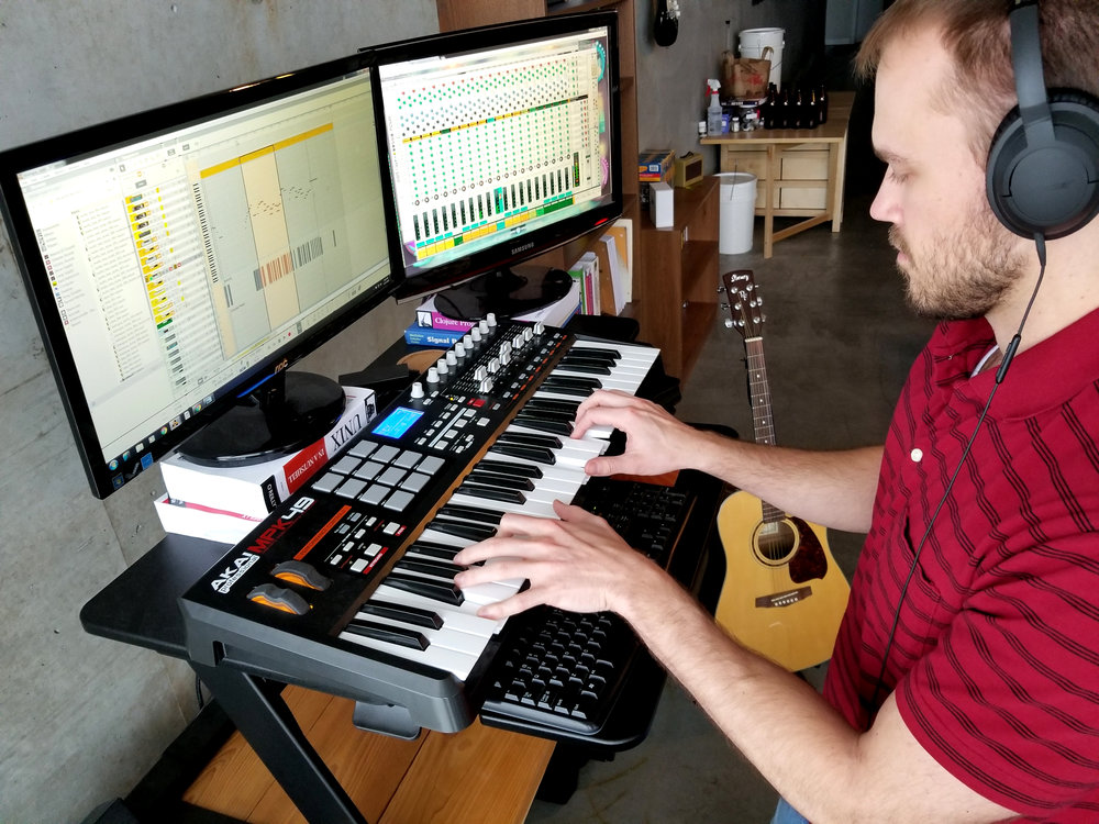 Andrew, composing in his studio.