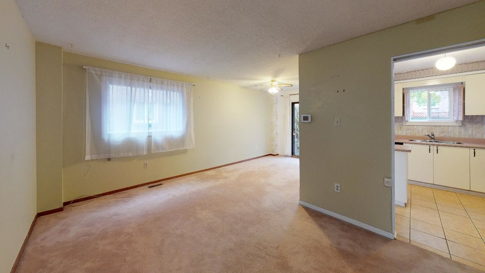 Pre-Reno-State-172-Radford-Drive-LivingDining-Room.jpg