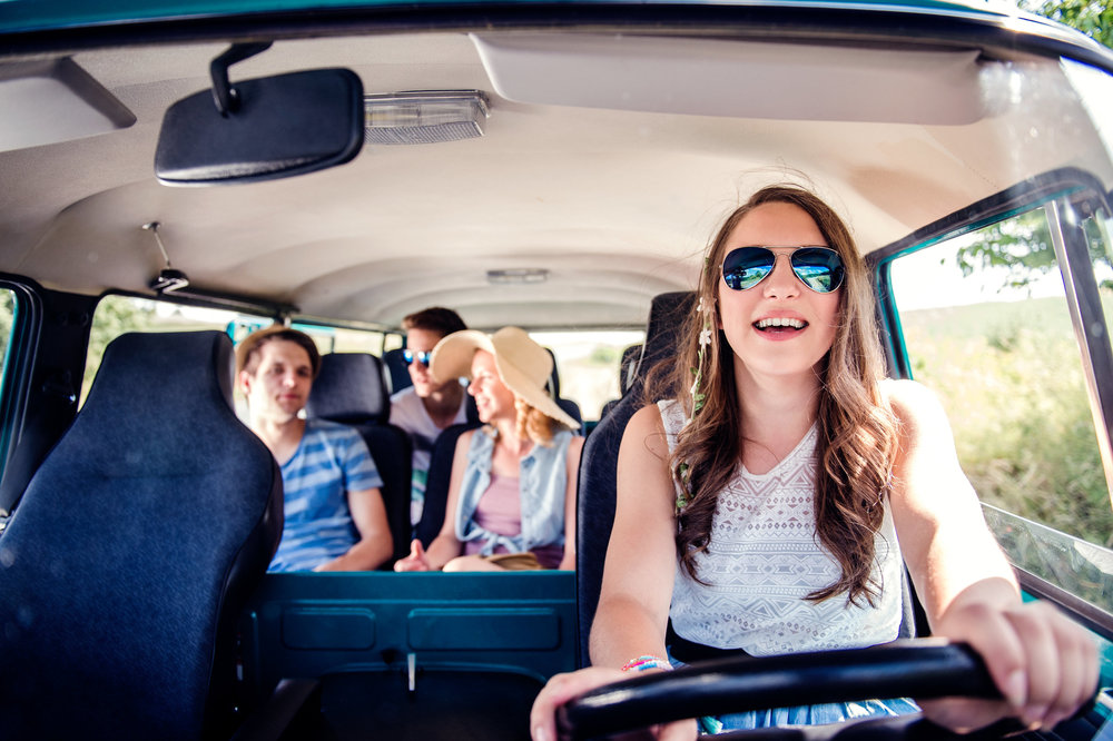 graphicstock-teenage-boys-and-girls-inside-an-old-campervan-on-a-roadtrip-girl-driving-sunny-summer-day_Bdb85D4rMW.jpg