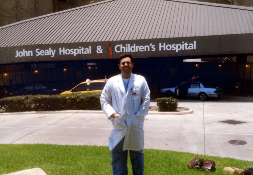 ^ Greg stands in front of John Sealy Hospital at UTMB-Galveston on his last day as an Internal Medicine resident. He was then accepted to the pulmonary/critical care fellowship at UTSW in Dallas.