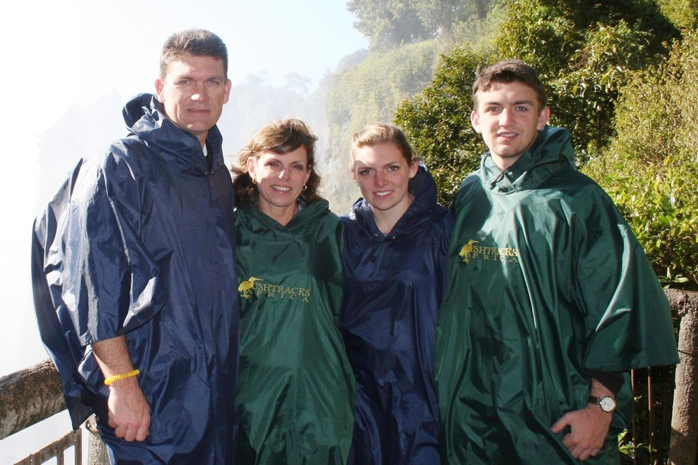 ^ Todd and Christy with their daughter, Cathryn (19) and son, Davis (22), at Victoria Falls.
