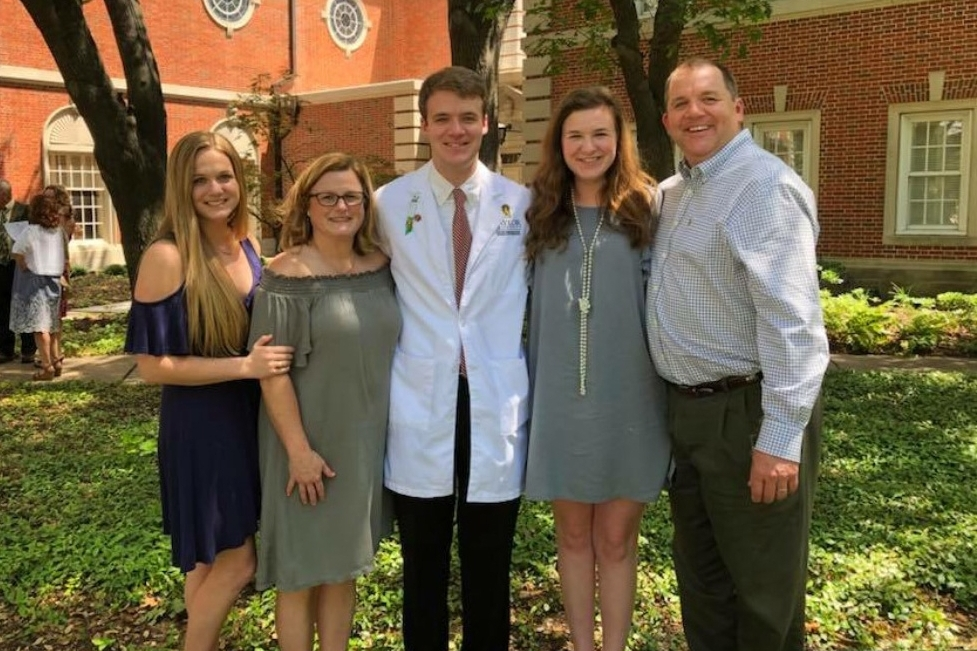 ^ Rich (right) and his wife, Allison (second from left), with their daughters, Mabrey (18) and Meredith (21), and son, Jackson (24) during Jackson's graduation from nursing school last month.