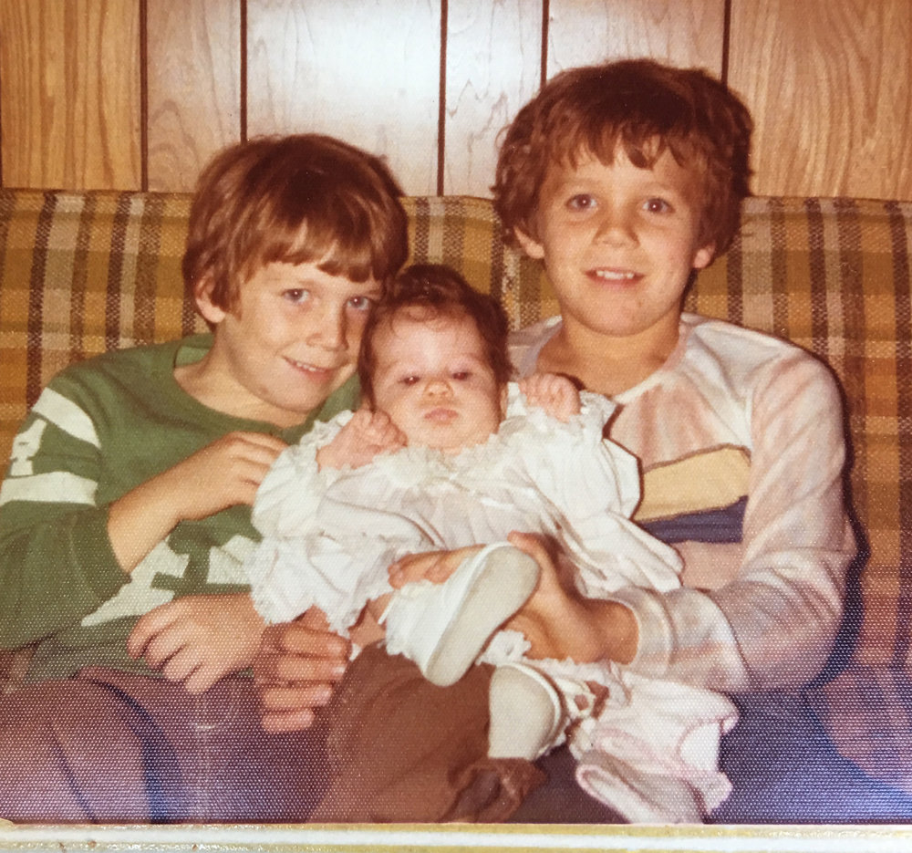 ^ Todd and Rich holding sister, Cara, in 1976.