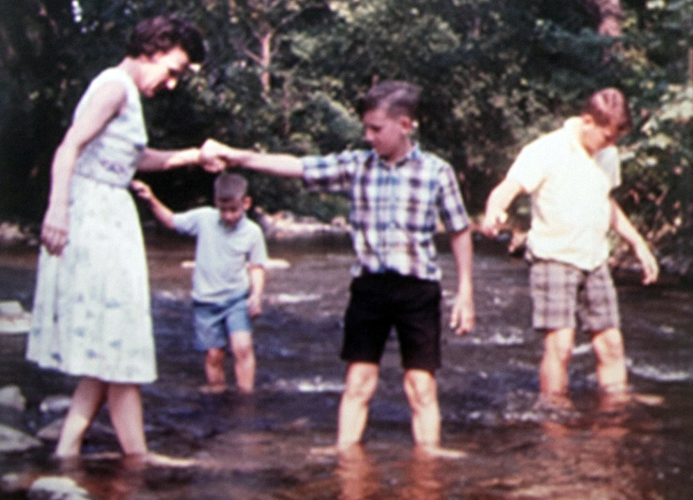 ^ Martha with her boys wading in the stream at the Cossatot River.
