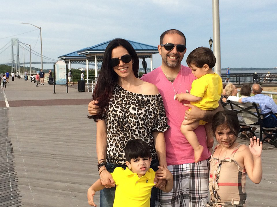 ^ Two years ago, Layla and Hesham and their three kids, Rawya, Ibrahim, and Omar, visited the Staten Island boardwalk.