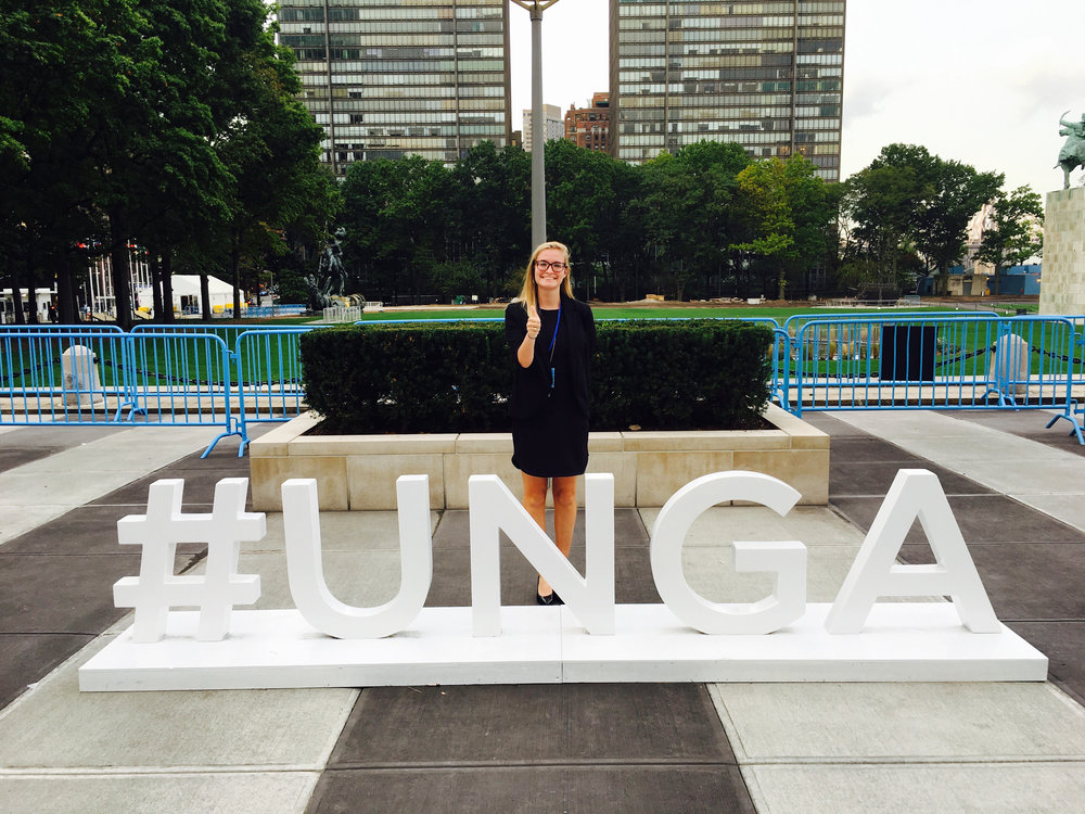 ^ In 2016, Paige posed by the UNGA (UN General Assembly) sign set up in New York.
