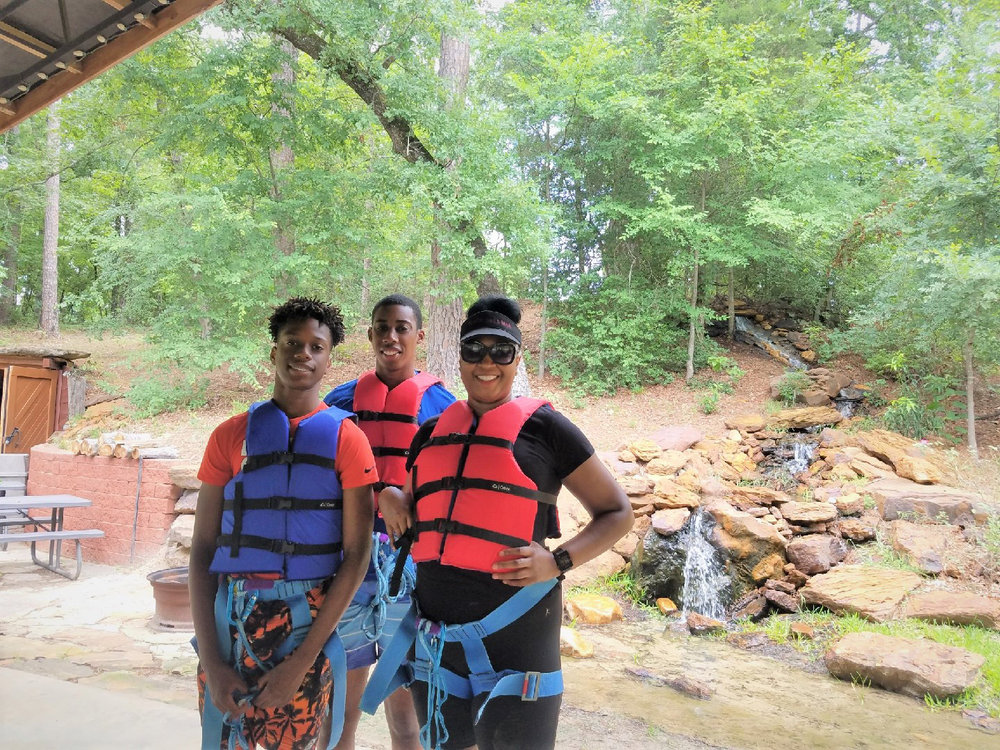 ^ Joyce and her boys, Jamaal and Christian, enjoy being active and doing fun activities together. Here, they are ziplining at Thomas Falls.