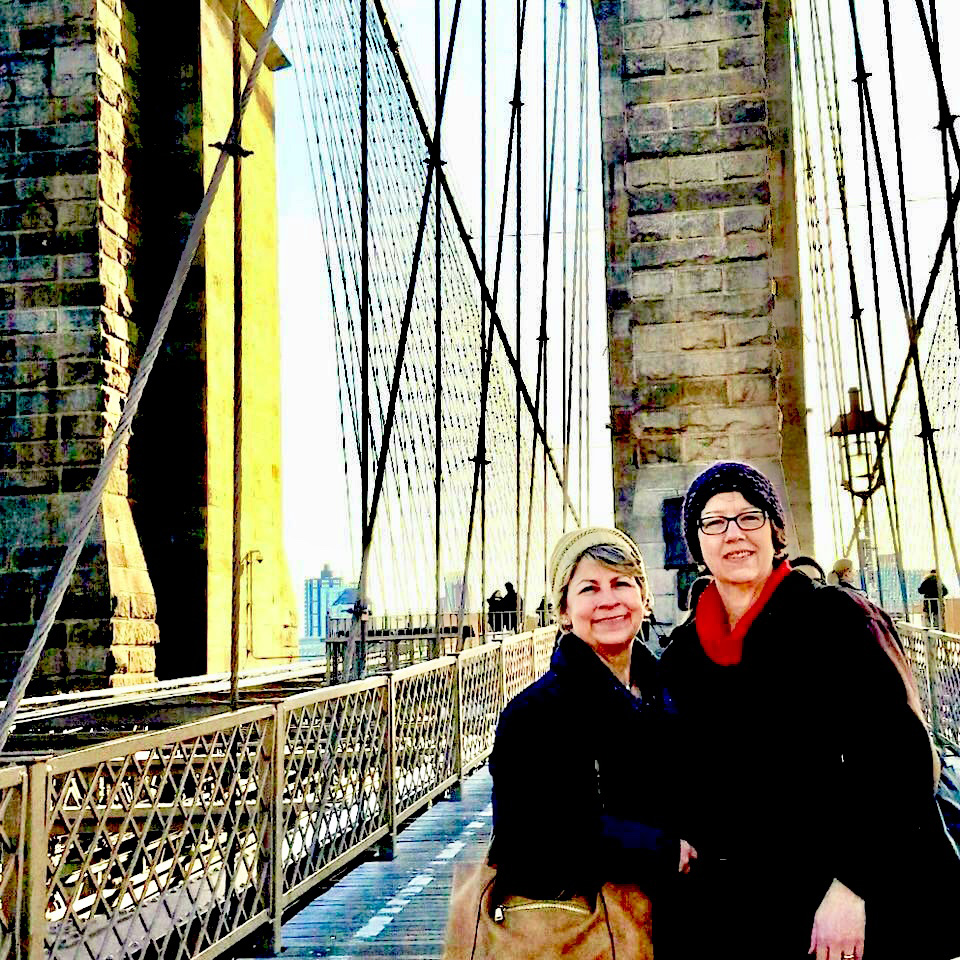 Agnes and her sister, Mary Helm, walking on the Brooklyn Bridge as part of a New York City trip in January 2017.